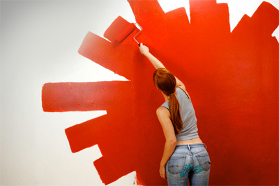 Girl-painting-wall-red